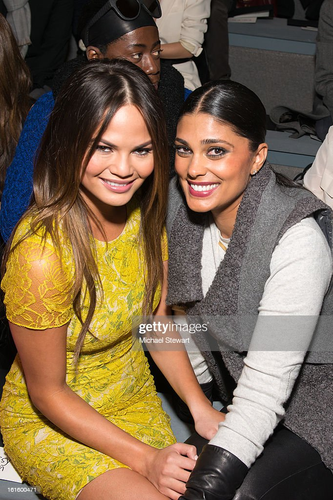 Model Chrissy Teigen (L) and designer Rachel Roy attend Vera Wang during fall 2013 Mercedes-Benz Fashion Week at The Stage at Lincoln Center on February 12, 2013 in New York City.