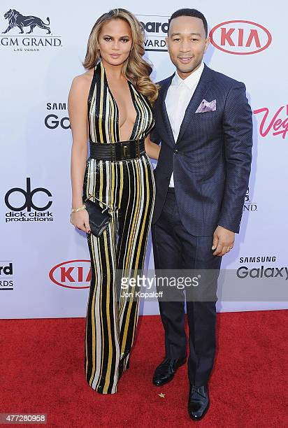 Model Chrissy Teigen and husband singer John Legend arrive at the 2015 Billboard Music Awards at MGM Garden Arena on May 17 2015 in Las Vegas Nevada