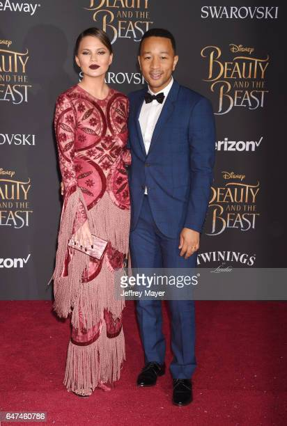Model Chrissy Teigen and husband/musician John Legend arrive at the Premiere Of Disney's 'Beauty And The Beast' at the El Capitan Theatre on March 2...
