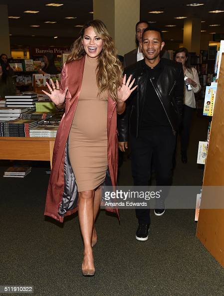 Model Chrissy Teigen and musician John Legend arrive to sign copies of Teigen's book 'Cravings Recipes For All The Food You Want To Eat' at Barnes...