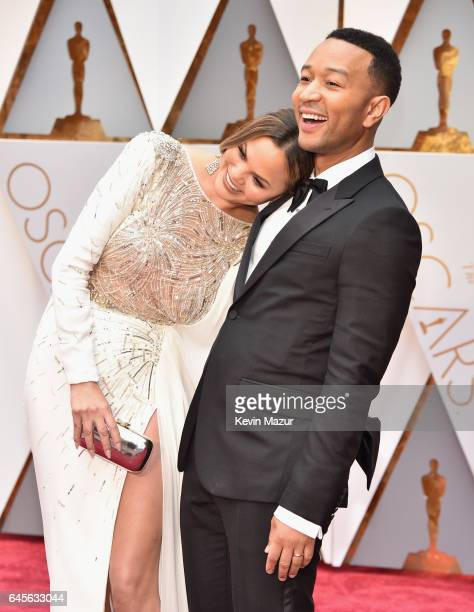 Model Chrissy Teigen and musician John Legend attend the 89th Annual Academy Awards at Hollywood Highland Center on February 26 2017 in Hollywood...