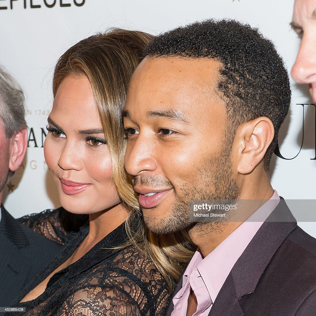 Model Chrissy Teigen (L) and musician <a gi-track='captionPersonalityLinkClicked' href=/galleries/search?phrase=John+Legend&family=editorial&specificpeople=201468 ng-click='$event.stopPropagation()'>John Legend</a> attend the DuJour celebration of cover star Chrissy Teigen at NYY Steak Manhattan on July 28, 2014 in New York City.