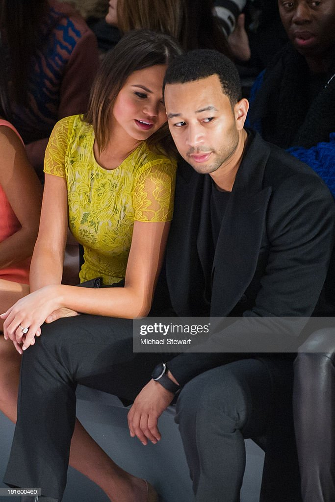 Model Chrissy Teigen (L) and musician John Legend attend Vera Wang during fall 2013 Mercedes-Benz Fashion Week at The Stage at Lincoln Center on February 12, 2013 in New York City.