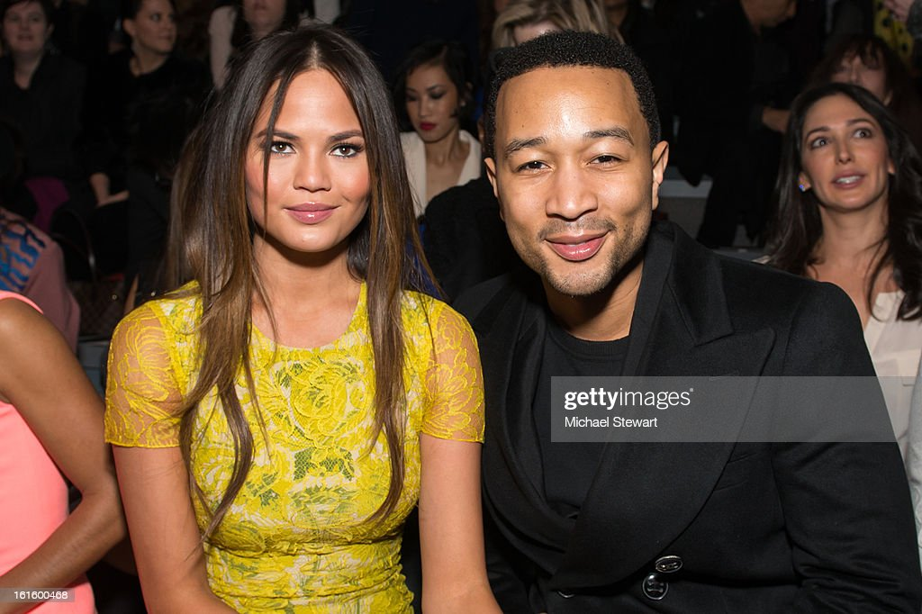 Model Chrissy Teigen (L) and musician <a gi-track='captionPersonalityLinkClicked' href=/galleries/search?phrase=John+Legend&family=editorial&specificpeople=201468 ng-click='$event.stopPropagation()'>John Legend</a> attend Vera Wang during fall 2013 Mercedes-Benz Fashion Week at The Stage at Lincoln Center on February 12, 2013 in New York City.