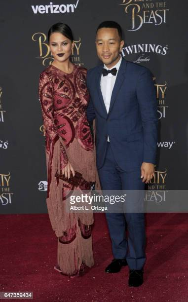 Model Chrissy Teigen and musician/husband John Legend arrive for the Premiere Of Disney's 'Beauty And The Beast' held at El Capitan Theatre on March...