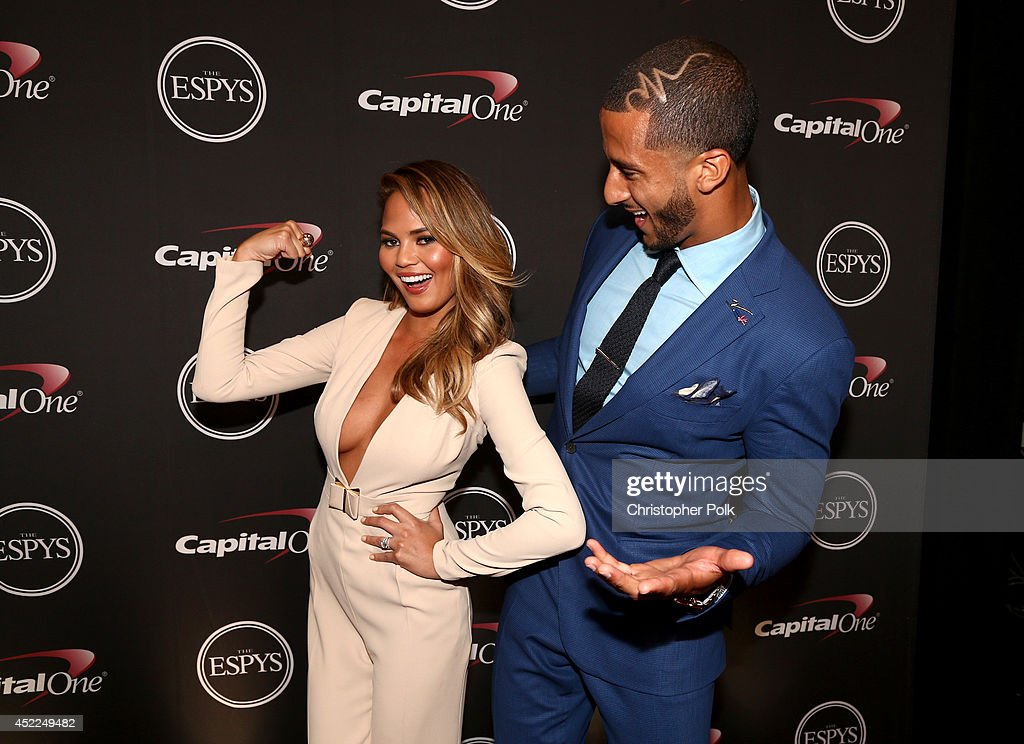 Model Chrissy Teigen and NFL quarterback <a gi-track='captionPersonalityLinkClicked' href=/galleries/search?phrase=Colin+Kaepernick&family=editorial&specificpeople=5525694 ng-click='$event.stopPropagation()'>Colin Kaepernick</a> backstage at The 2014 ESPYS at Nokia Theatre L.A. Live on July 16, 2014 in Los Angeles, California.