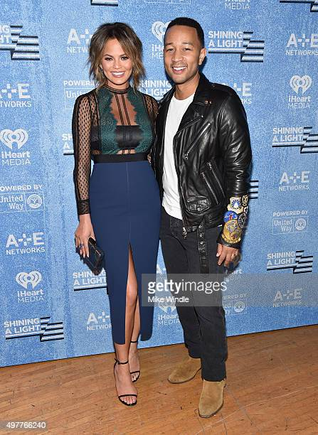 Model Chrissy Teigen and recording artist John Legend attend AE Networks 'Shining A Light' concert at The Shrine Auditorium on November 18 2015 in...