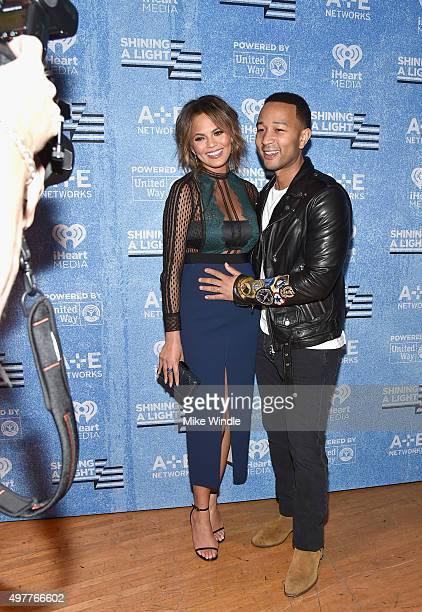 Model Chrissy Teigen and recording artist John Legend attend AE Networks 'Shining A Light' concert at The Shrine Auditorium on November 18 2015 in...