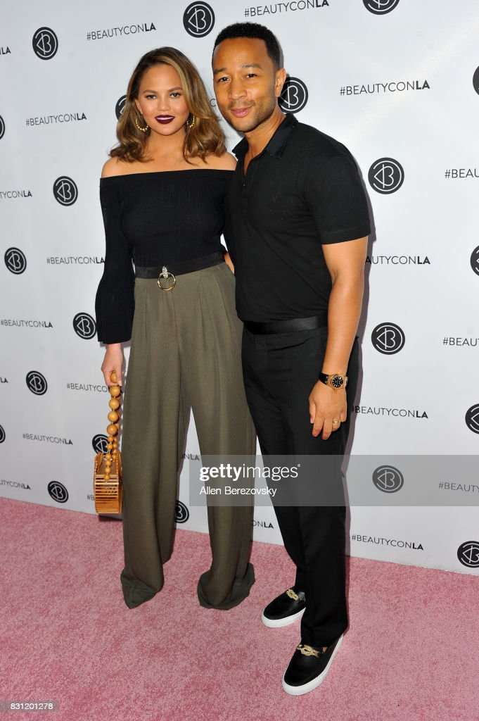 Model Chrissy Teigen and recording artist John Legend attend the 5th Annual Beautycon Festival Los Angeles at Los Angeles Convention Center on August 13, 2017 in Los Angeles, California.