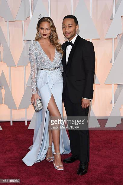Model Chrissy Teigen and recording artist John Legend attend the 87th Annual Academy Awards at Hollywood Highland Center on February 22 2015 in...