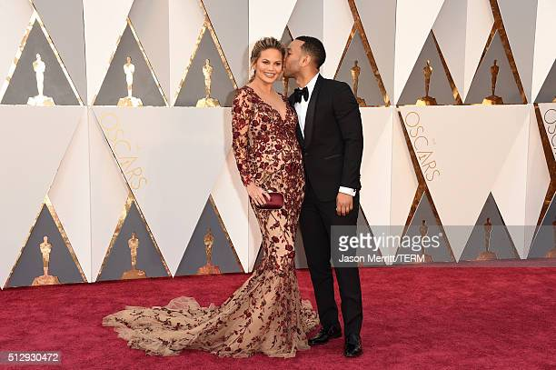 Model Chrissy Teigen and recording artist John Legend attend the 88th Annual Academy Awards at Hollywood Highland Center on February 28 2016 in...