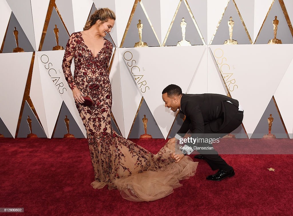 Model Chrissy Teigen (L) and recording artist <a gi-track='captionPersonalityLinkClicked' href=/galleries/search?phrase=John+Legend&family=editorial&specificpeople=201468 ng-click='$event.stopPropagation()'>John Legend</a> attend the 88th Annual Academy Awards at Hollywood & Highland Center on February 28, 2016 in Hollywood, California.