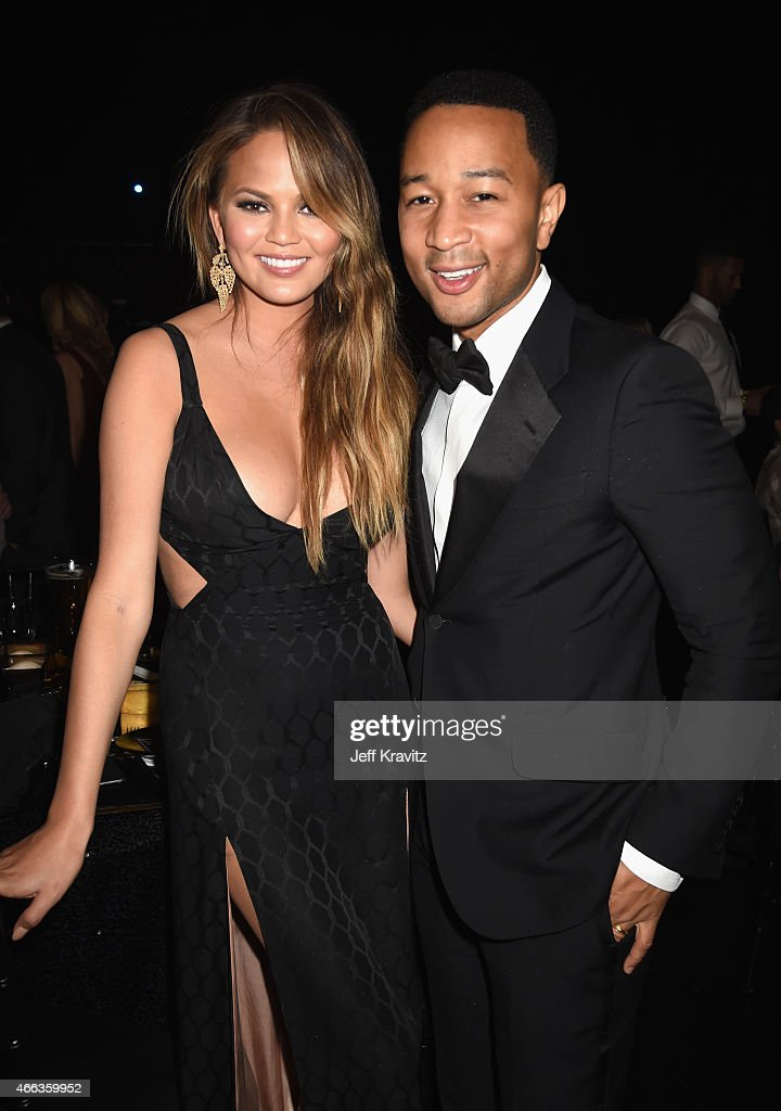 Model Chrissy Teigen (L) and recording artist John Legend attend The Comedy Central Roast of Justin Bieber at Sony Pictures Studios on March 14, 2015 in Los Angeles, California. The Comedy Central Roast of Justin Bieber will air on March 30, 2015 at 10:00 p.m. ET/PT.