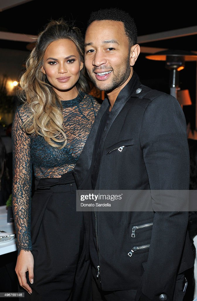 Model Chrissy Teigen (L) and recording artist John Legend attend The Hollywood Reporter's Beauty Dinner at The London West Hollywood on November 11, 2015 in West Hollywood, California.