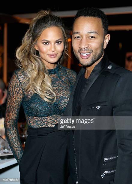 Model Chrissy Teigen and recording artist John Legend attend The Hollywood Reporter's Beauty Dinner at The London West Hollywood on November 11 2015...