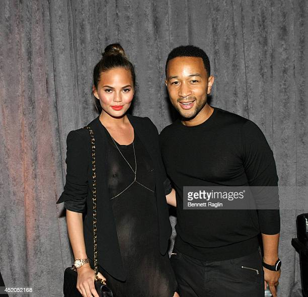 Model Chrissy Teigen and recording artist John Legend attend the D'USSE VIP Riser Lounge At On The Run Tour MetLife Stadium on July 11 2014 in East...