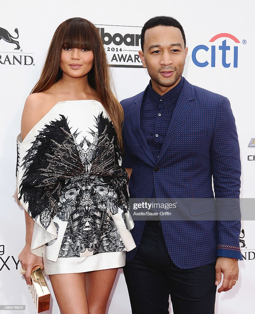 Model Chrissy Teigen and singer John Legend arrive at the 2014 Billboard Music Awards at the MGM Grand Garden Arena on May 18, 2014 in Las Vegas, Nevada.