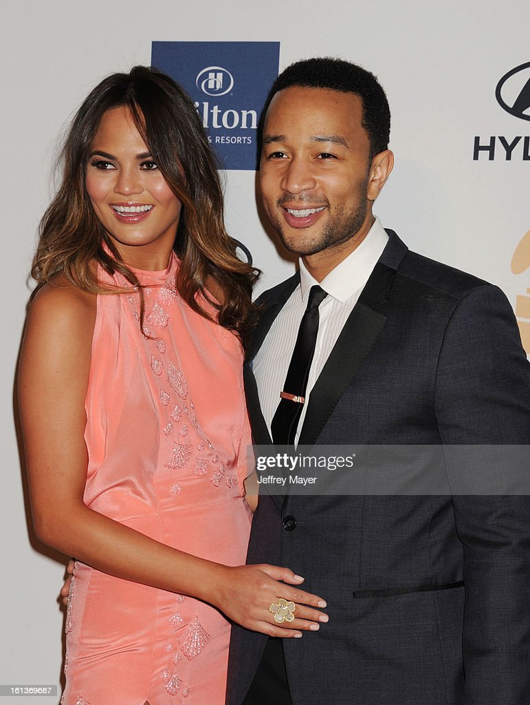 Model Chrissy Teigen and singer John Legend arrive at the The 55th Annual GRAMMY Awards - Pre-GRAMMY Gala And Salute To Industry Icons Honoring L.A. Reid at the Beverly Hilton Hotel on February 9, 2013 in Los Angeles, California.