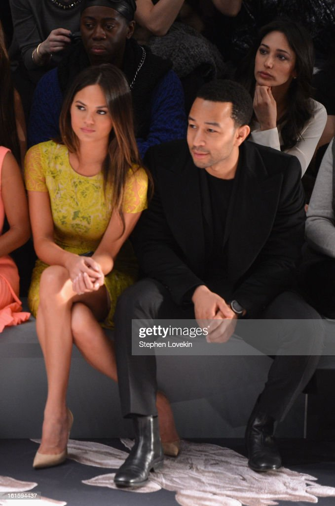 Model Chrissy Teigen and singer <a gi-track='captionPersonalityLinkClicked' href=/galleries/search?phrase=John+Legend&family=editorial&specificpeople=201468 ng-click='$event.stopPropagation()'>John Legend</a> attend the Vera Wang Fall 2013 fashion show during Mercedes-Benz Fashion Week at The Stage at Lincoln Center on February 12, 2013 in New York City.
