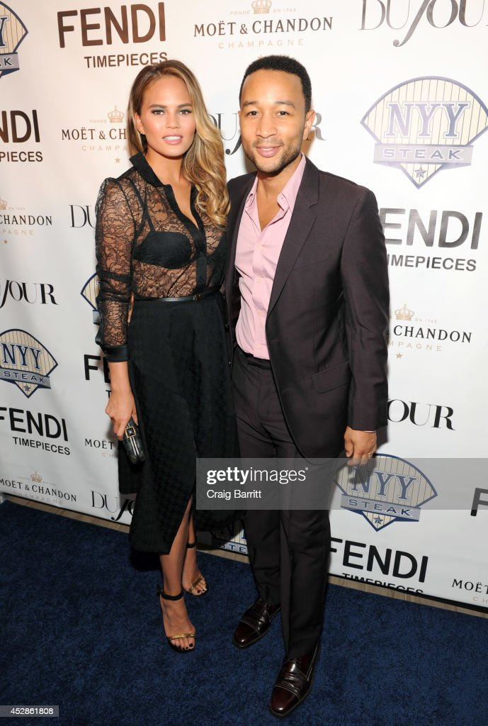 Model Chrissy Teigen (L) and singer-songwriter John Legend attend DuJour Magazine and NYY Steak celebrating Chrissy Teigen with FENDI timepieces and Moet Ice on July 28, 2014 in New York City.