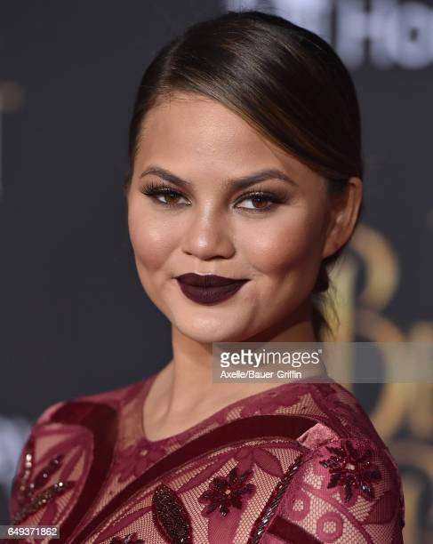 Model Chrissy Teigen arrives at the Los Angeles Premiere of 'Beauty and the Beast' at El Capitan Theatre on March 2 2017 in Los Angeles California
