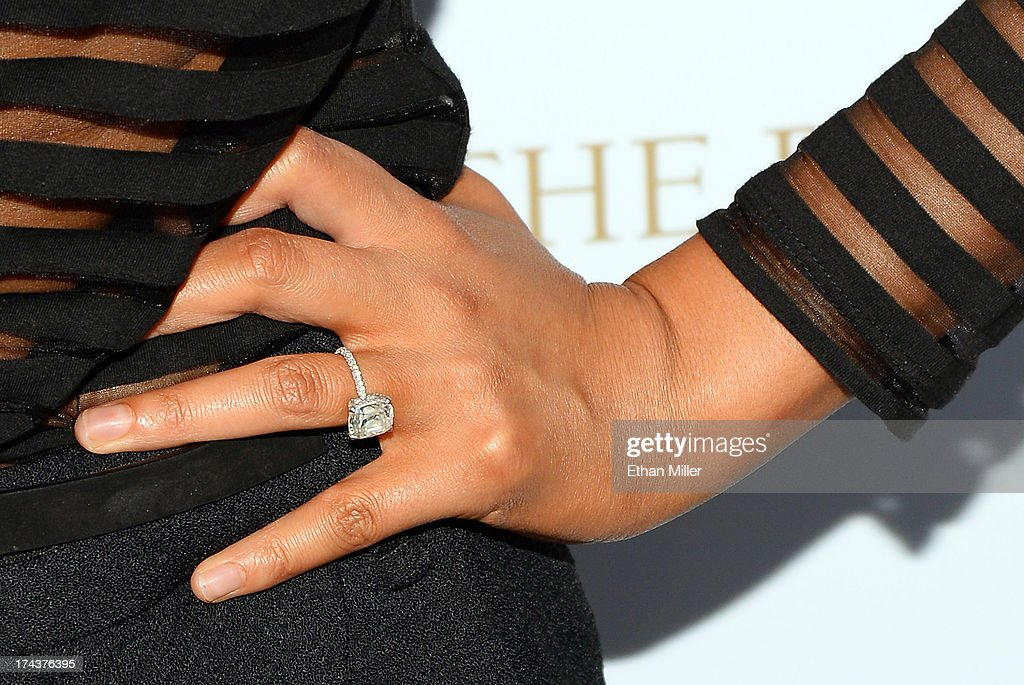 Model Chrissy Teigen (engagement ring detail) arrives at Vegas Magazine's summer issue party at the Azure Luxury Pool at The Palazzo Las Vegas on July 24, 2013 in Las Vegas, Nevada.