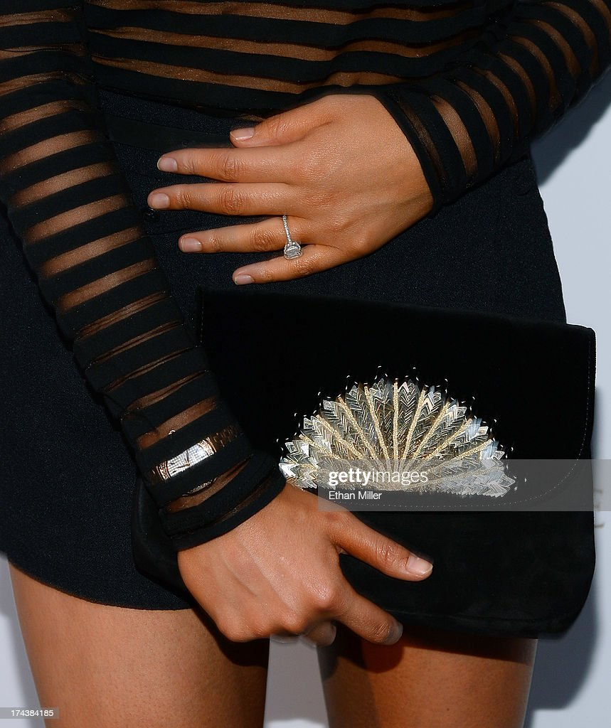 Model Chrissy Teigen (purse, engagement ring details) arrives at Vegas Magazine's summer issue party at the Azure Luxury Pool at The Palazzo Las Vegas on July 24, 2013 in Las Vegas, Nevada.