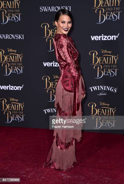 Model Chrissy Teigen attends Disney's 'Beauty and the Beast' premiere at El Capitan Theatre on March 2 2017 in Los Angeles California