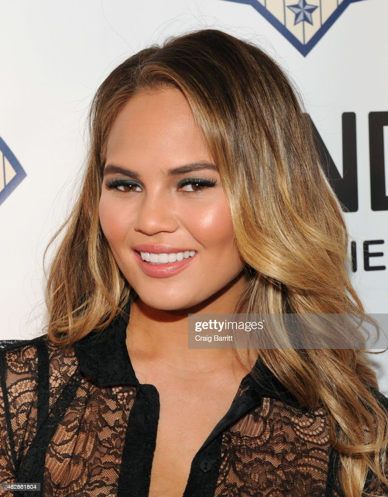 Model Chrissy Teigen attends DuJour Magazine and NYY Steak celebrating Chrissy Teigen with FENDI timepieces and Moet Ice on July 28, 2014 in New York City.