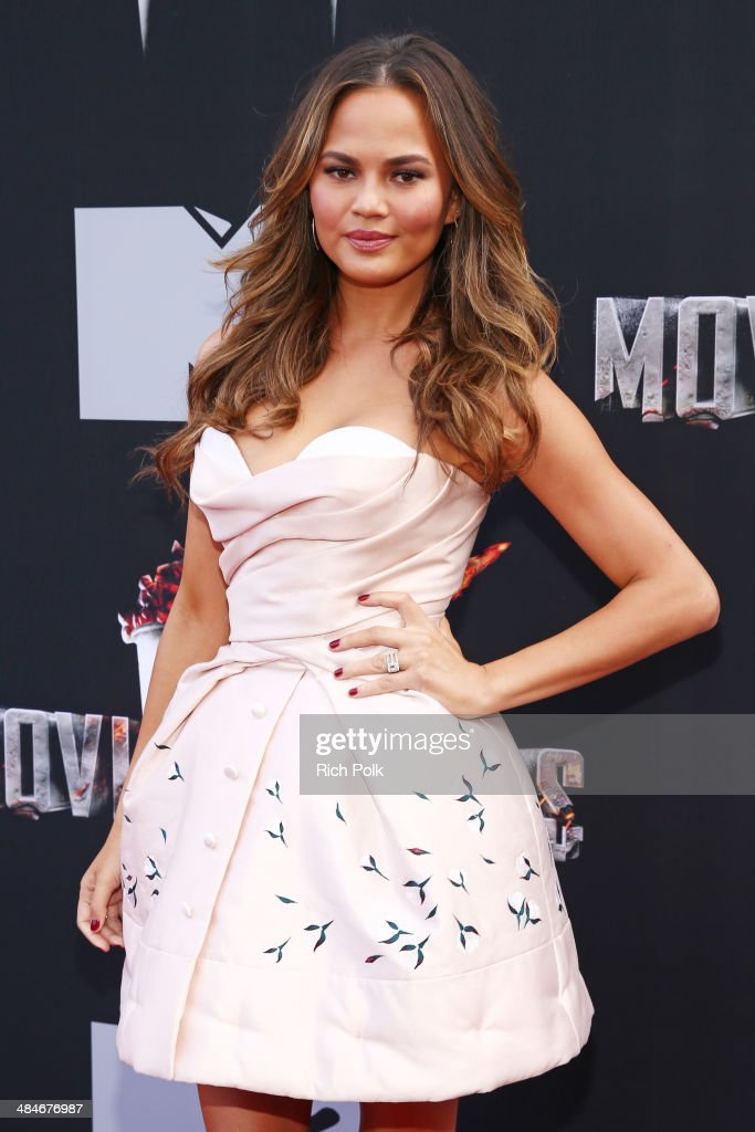 Model Chrissy Teigen attends the 2014 MTV Movie Awards at Nokia Theatre L.A. Live on April 13, 2014 in Los Angeles, California.