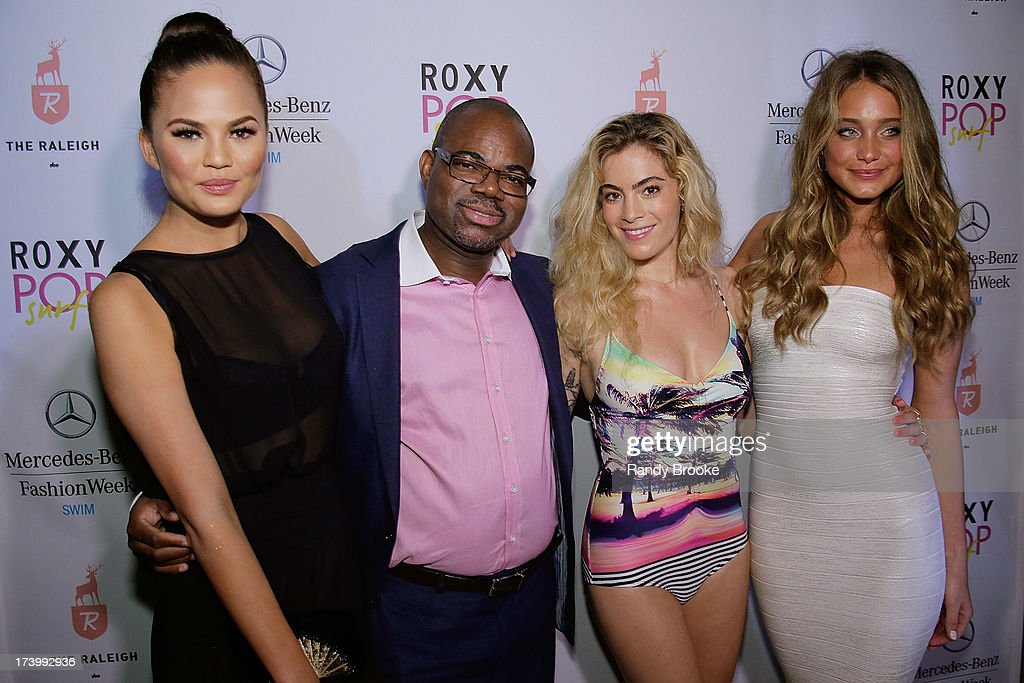 Model Chrissy Teigen, Isaac Daniel (founder of Reel Code Media), DJ Chelsea Leyland and model Hannah Davis on the red carpet at Mercedes-Benz Fashion Week Swim 2014 - Kick Off Party at Raleigh Hotel on July 18, 2013 in Miami Beach, Florida.