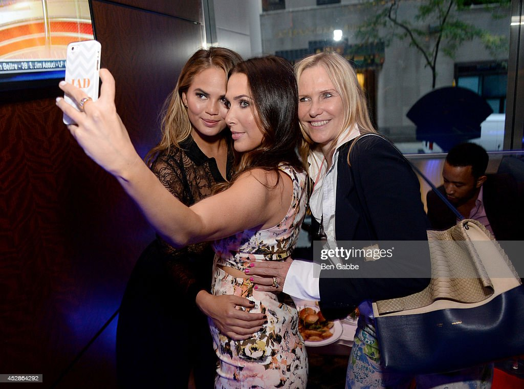 Model Chrissy Teigen, Jordan Duffy and Susan Duffy attend DuJour Magazine and NYY Steak celebrating Chrissy Teigen with FENDI timepieces and Moet Ice on July 28, 2014 in New York City.