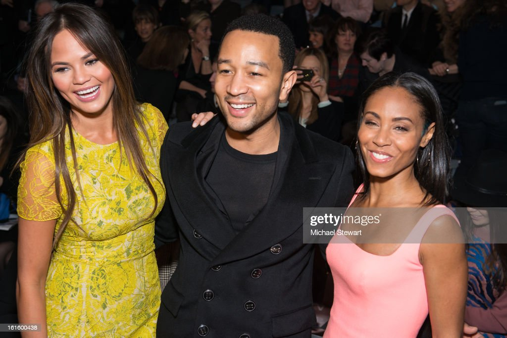 Model Chrissy Teigen, musician John Legend and actress Jada Pinkett Smith attend Vera Wang during fall 2013 Mercedes-Benz Fashion Week at The Stage at Lincoln Center on February 12, 2013 in New York City.