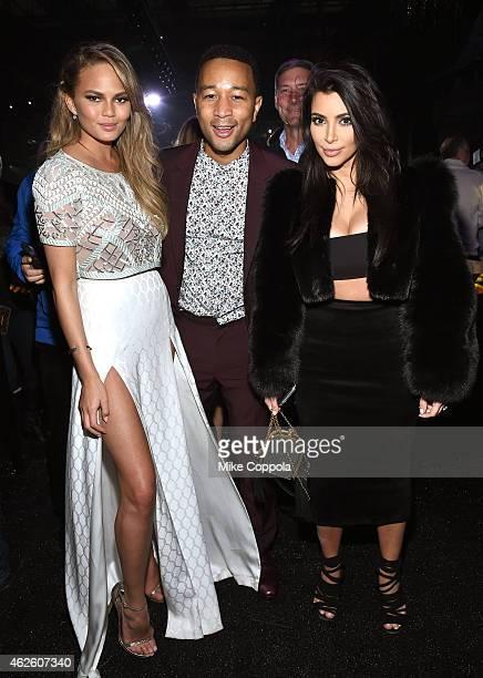 Model Chrissy Teigen recording artist John Legend and TV personality Kim Kardashian attend DirecTV Super Saturday Night hosted by Mark Cuban's AXS TV...