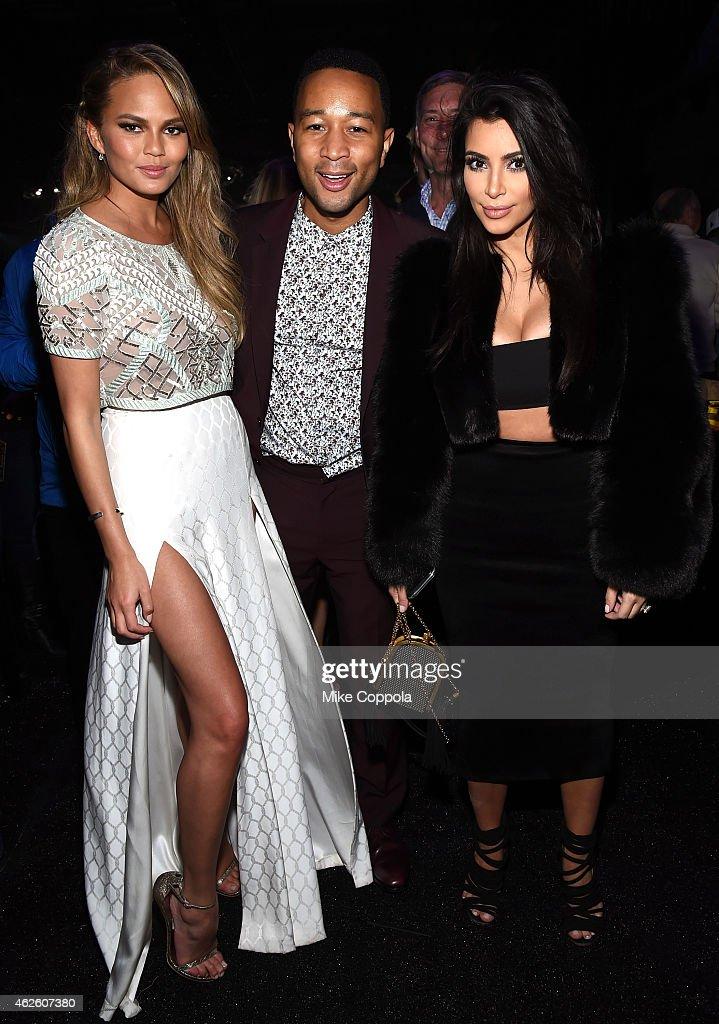 Model Chrissy Teigen, recording artist John Legend and TV personality Kim Kardashian attend DirecTV Super Saturday Night hosted by Mark Cuban's AXS TV and Pro Football Hall of Famer Michael Strahan at Pendergast Family Farm on January 31, 2015 in Glendale, Arizona.