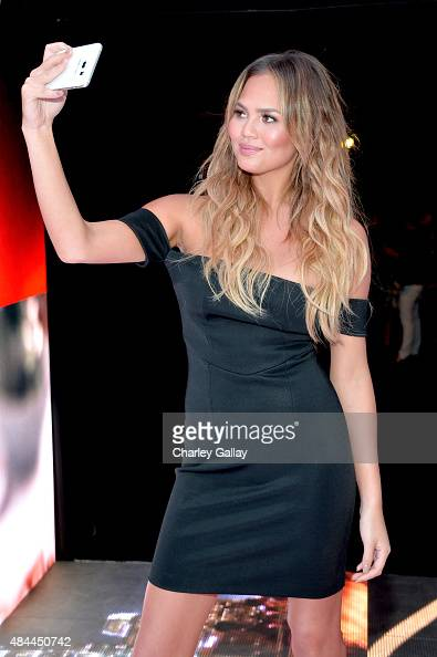 Model Chrissy Teigen takes a selfie to celebrate the new Samsung Galaxy S6 edge and Galaxy Note5 at Launch Event on August 18 2015 in Los Angeles...