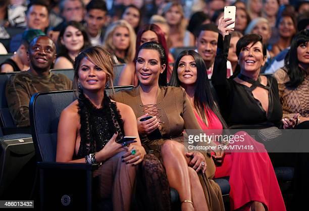 Model Chrissy Teigen TV personalities Kim Kardashian Kourtney Kardashian and Kris Jenner attend the 2015 MTV Video Music Awards at Microsoft Theater...