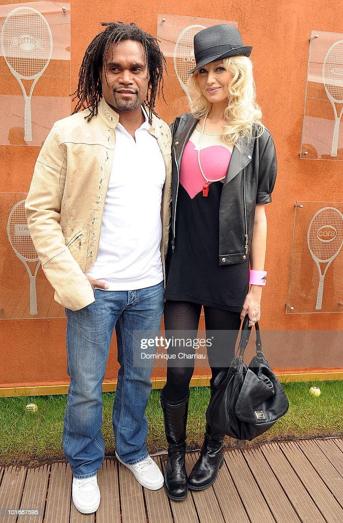 Model <a gi-track='captionPersonalityLinkClicked' href=/galleries/search?phrase=Christian+Karembeu&family=editorial&specificpeople=228704 ng-click='$event.stopPropagation()'>Christian Karembeu</a> and <a gi-track='captionPersonalityLinkClicked' href=/galleries/search?phrase=Adriana+Karembeu&family=editorial&specificpeople=207098 ng-click='$event.stopPropagation()'>Adriana Karembeu</a> are seen at the French Open on June 6, 2010 in Paris, France.