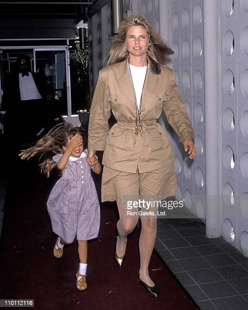Model Christie Brinkley and daughter Alexa Ray Joel on July 16 1990 arrive at the Los Angeles International Airport in Los Angeles California