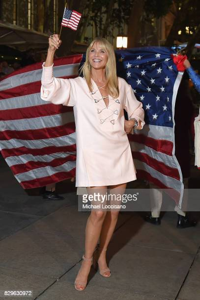Model Christie Brinkley joins a procession from the theater to the after party as awardwinning filmmaker Michael Moore celebrates his Broadway...