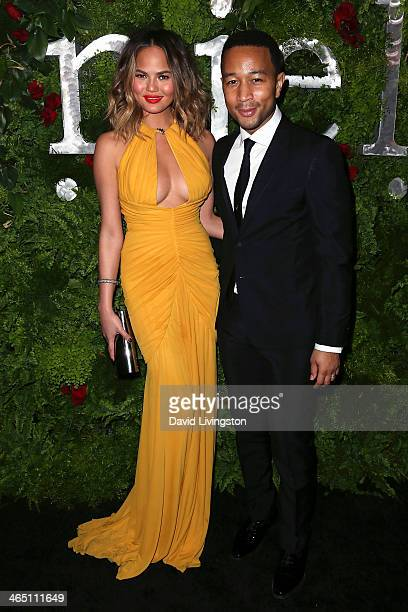 Model Christine Teigen and husband recording artist John Legend attend the Nielsen Host PreGrammy Celebration at Herringbone Mondrian LA on January...