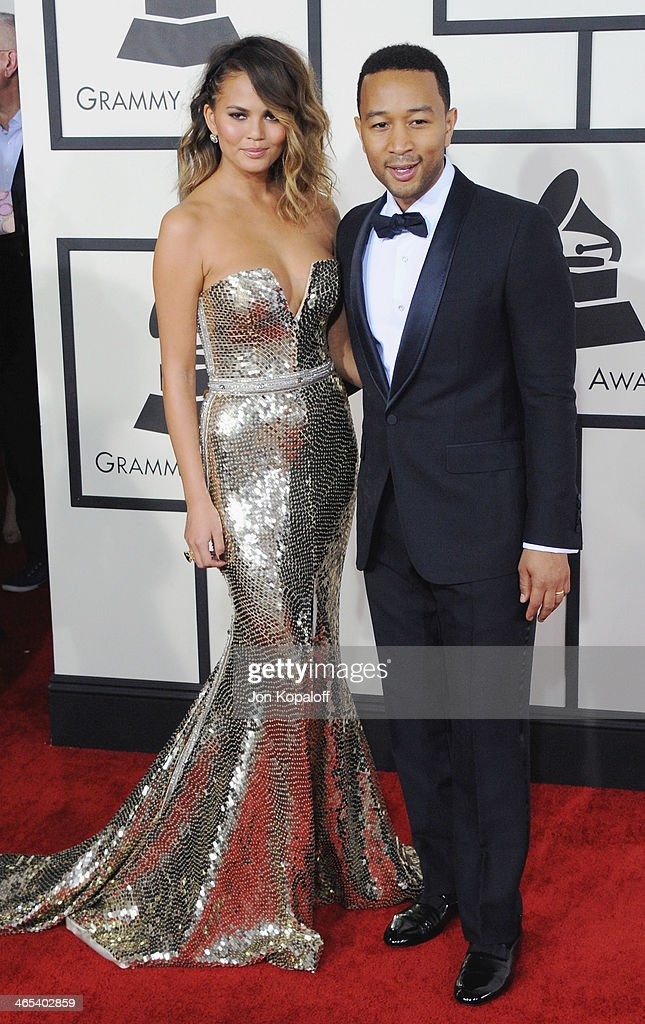 Model Christine Teigen and John Legend arrive at the 56th GRAMMY Awards at Staples Center on January 26, 2014 in Los Angeles, California.