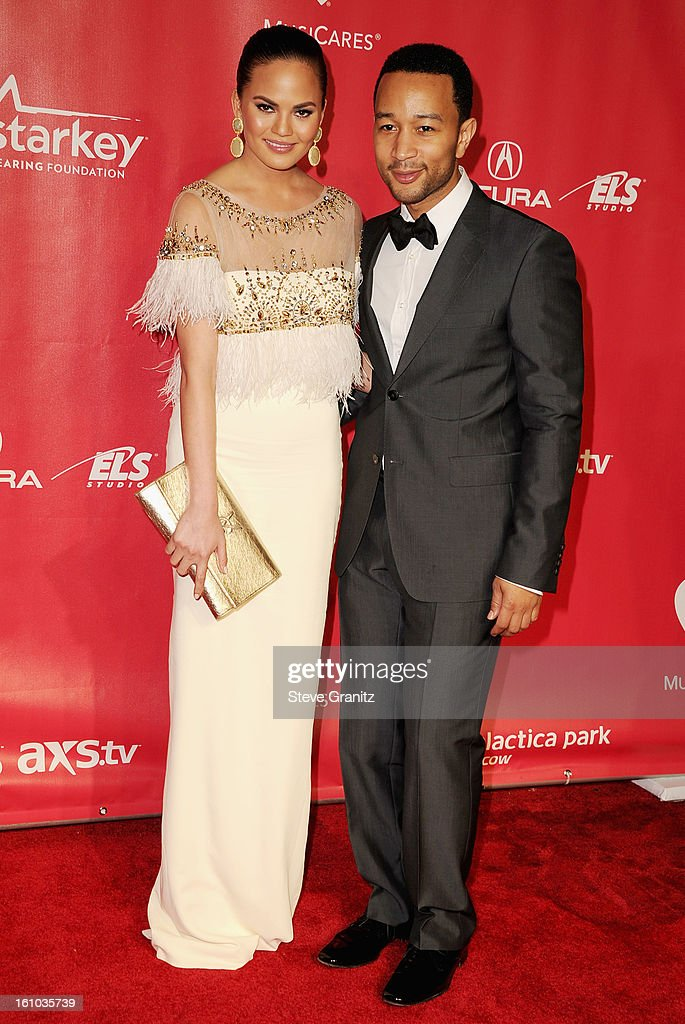Model Christine Teigen and musician John Legend attend MusiCares Person Of The Year Honoring Bruce Springsteen at Los Angeles Convention Center on February 8, 2013 in Los Angeles, California.