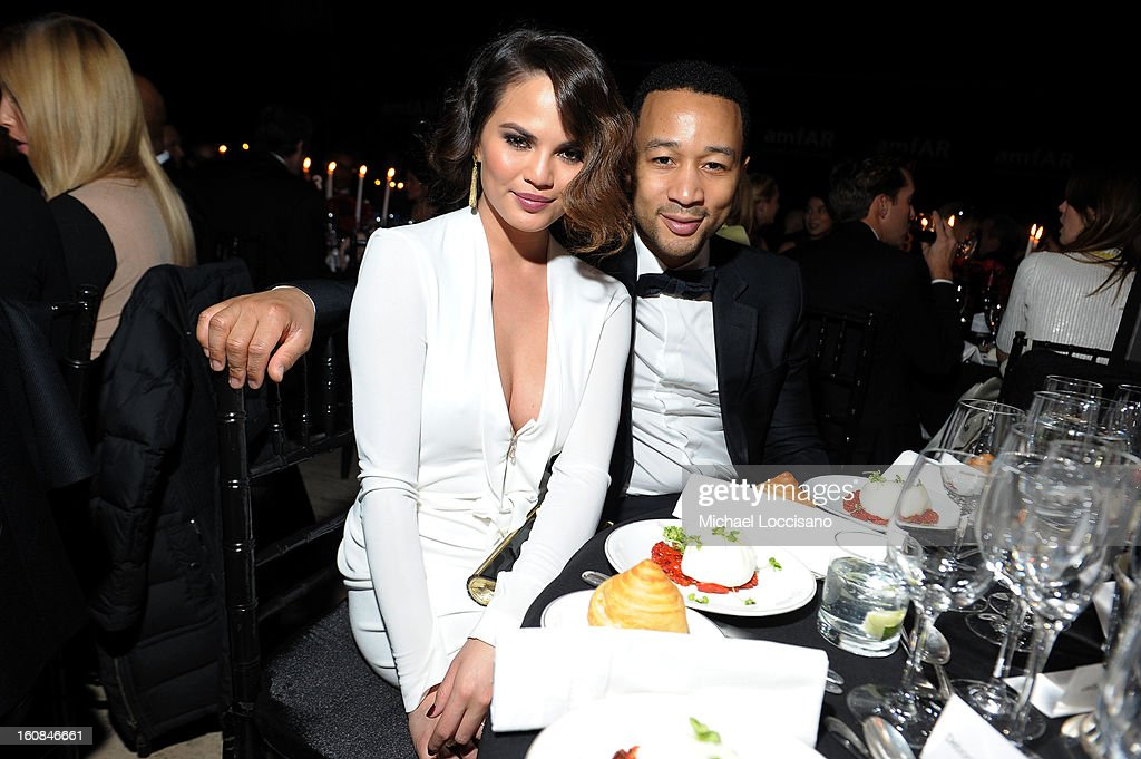 Model Christine Teigen and musician John Legend attend the amfAR New York Gala to kick off Fall 2013 Fashion Week at Cipriani Wall Street on February 6, 2013 in New York City.