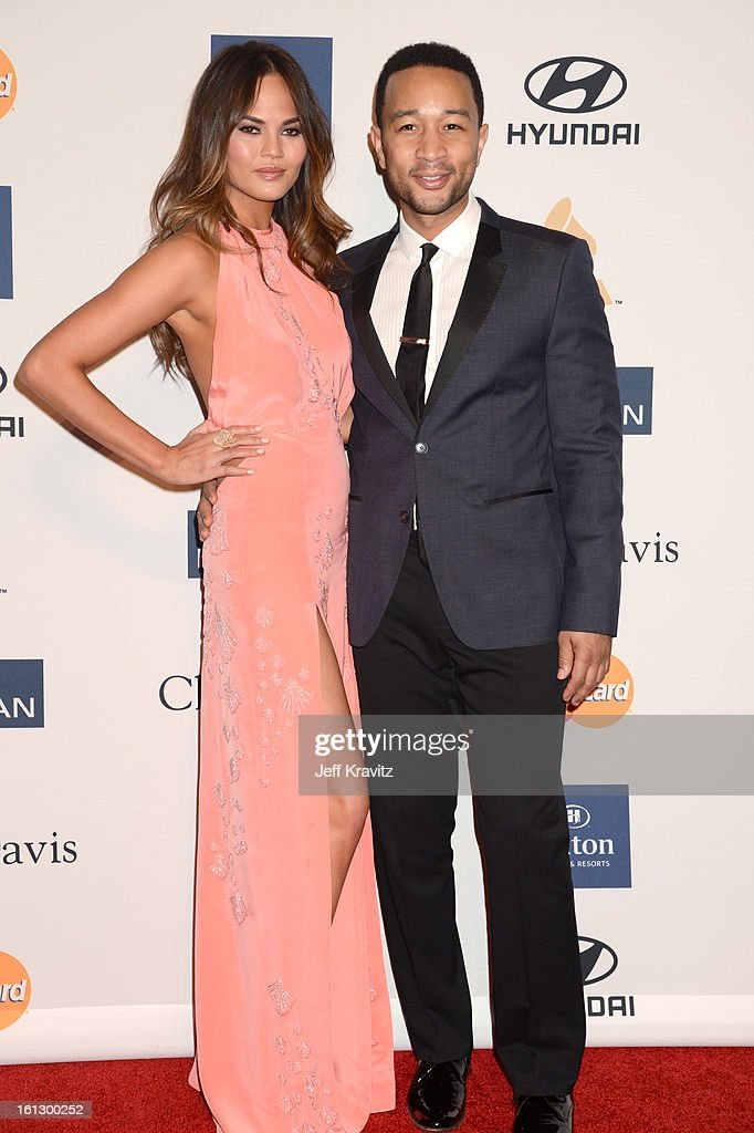 Model Christine Teigen and singer John Legend (R) arrive at Clive Davis and The Recording Academy's 2013 GRAMMY Salute to Industry Icons Gala held at The Beverly Hilton Hotel on February 9, 2013 in Beverly Hills, California.