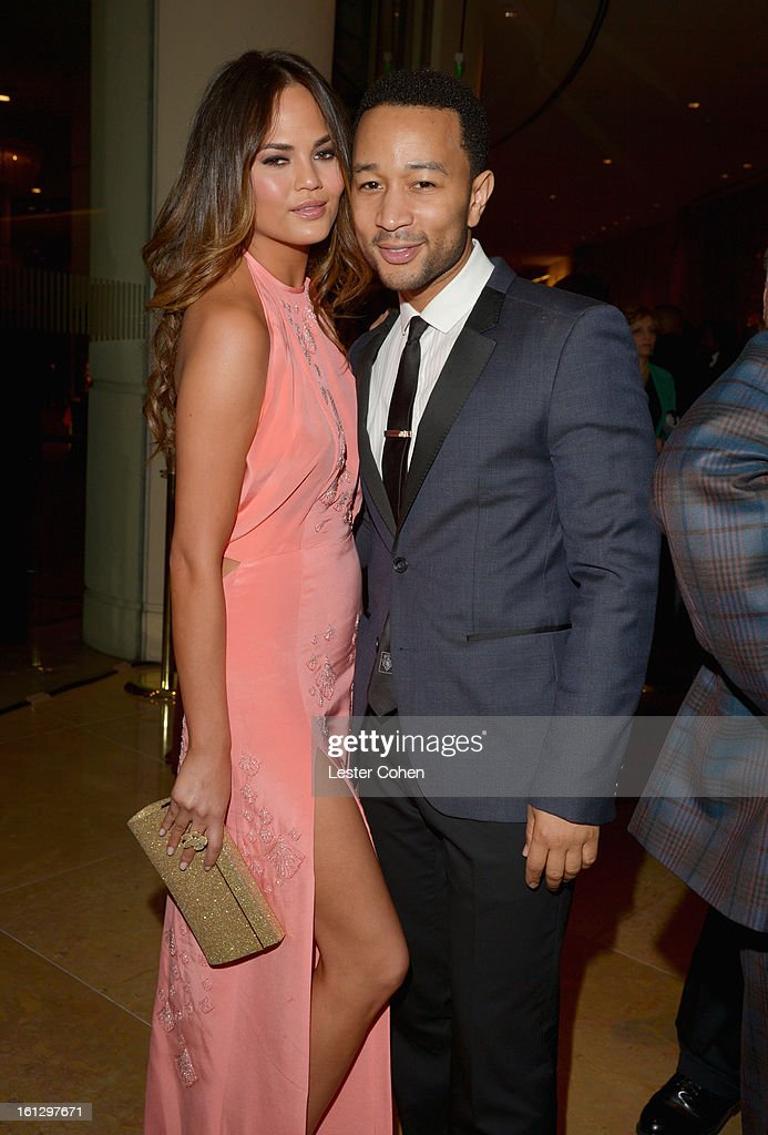 Model Christine Teigen and singer John Legend arrive at the 55th Annual GRAMMY Awards Pre-GRAMMY Gala and Salute to Industry Icons honoring L.A. Reid held at The Beverly Hilton on February 9, 2013 in Los Angeles, California.
