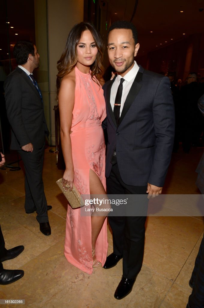 Model Christine Teigen (L) and singer John Legend arrive at the 55th Annual GRAMMY Awards Pre-GRAMMY Gala and Salute to Industry Icons honoring L.A. Reid held at The Beverly Hilton on February 9, 2013 in Los Angeles, California.