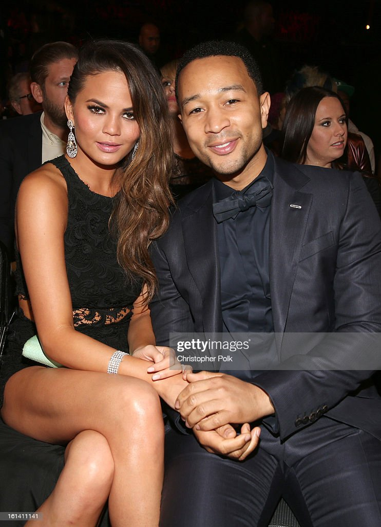 Model Christine Teigen (L) and singer John Legend attend the 55th Annual GRAMMY Awards at STAPLES Center on February 10, 2013 in Los Angeles, California.