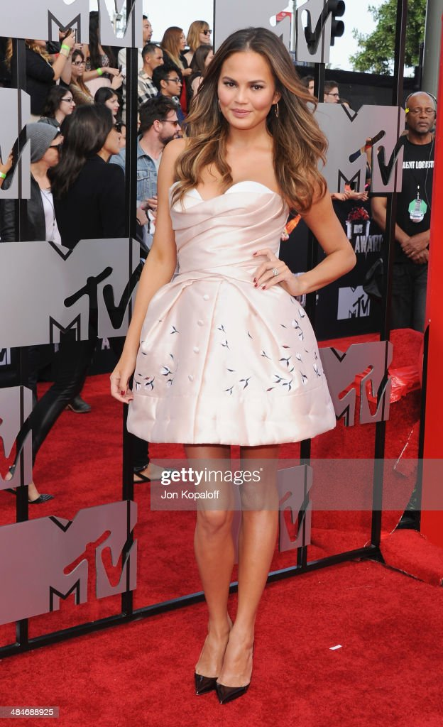 Model Christine Teigen arrives at the 2014 MTV Movie Awards at Nokia Theatre L.A. Live on April 13, 2014 in Los Angeles, California.