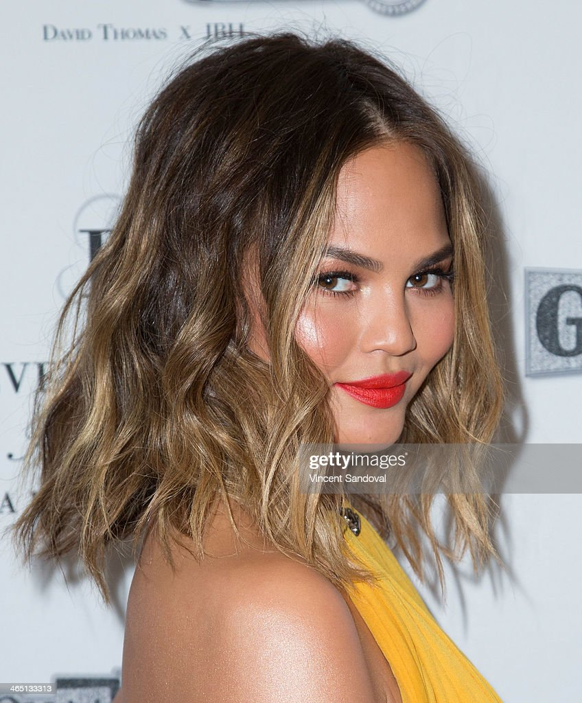 Model Christine Teigen attends Jason Of Beverly Hills' Pre-GRAMMY cocktail hour and salute to fashion icon David Thomas' Gentleman Collection at The Blvd on January 25, 2014 in Los Angeles, California.